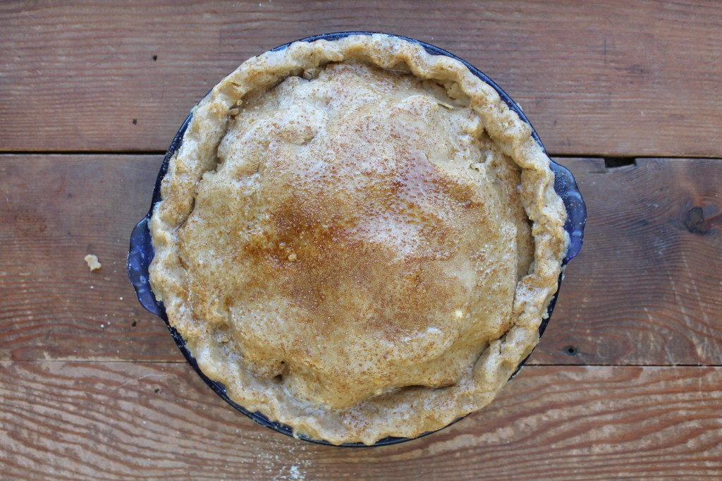 and the top crust, which you'll roll out and transfer the same way you did the bottom. It's brushed with egg whites, and sprinkled with coconut sugar, too.